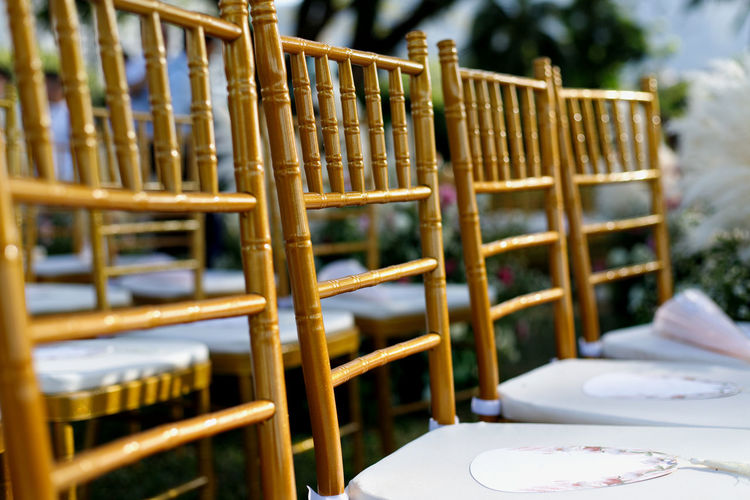 Chairs for wedding ceremony Chair Focus On Foreground No People Seat Absence Furniture Day Selective Focus Empty Outdoors Still Life Close-up Setting Arrangement Wedding Garden Gold Colored Reception Aisle Decoration Background Beautiful Celebration Ceremony Event Elegant Marriage  Nature Romantic Setting Venue