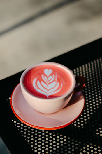 High angle view of cappuccino on table