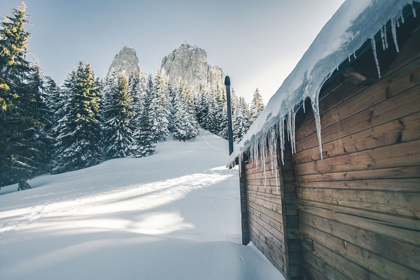 Architecture Beauty In Nature Built Structure Cold Temperature Day Frozen Mountain Nature No People Outdoors Plant Scenics - Nature Sky Snow Snowcapped Mountain Sunlight Tranquil Scene Tranquility Tree Winter