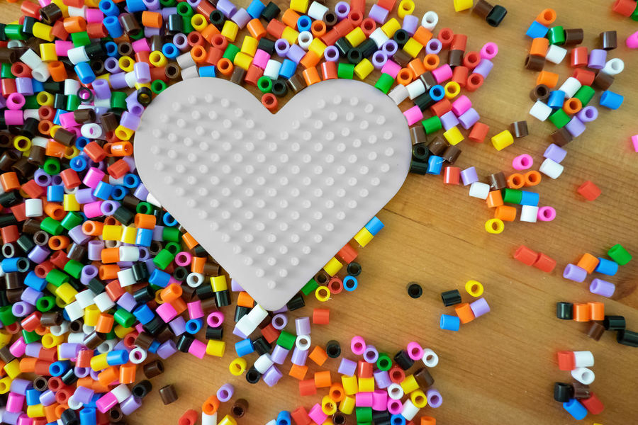 Love is colour blind Heart Shape Large Group Of Objects Multi Colored Love Emotion Indoors  Still Life Positive Emotion High Angle View No People Design Close-up Shape Table Valentine's Day - Holiday Arrangement Creativity Toy Beads Colourful Pieces Love Flat Lay Items Objects
