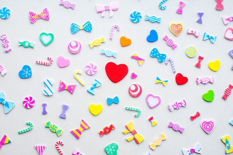 Full frame shot of colorful decorations against white background