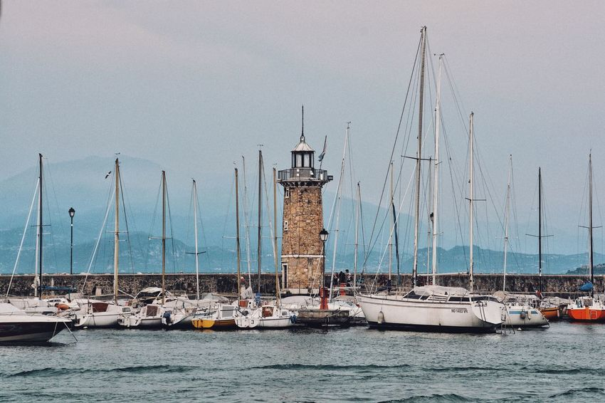 Water Parking Lot. Mountains And Lakes Mountain Range Pier Lake Ocean Nautical Vessel Transportation Mode Of Transportation Water Sailboat Sea Mast Pole Sailing Waterfront Tower Harbor Lighthouse Travel