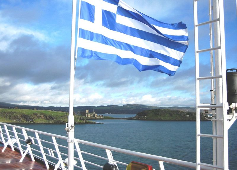 Inchcolm Island seen from the decks of the ferry from Belgium to Scotland Clear Sky Crossing The Sea Ferry Flag Historical Building Journey Scotland Sea Striped Wind