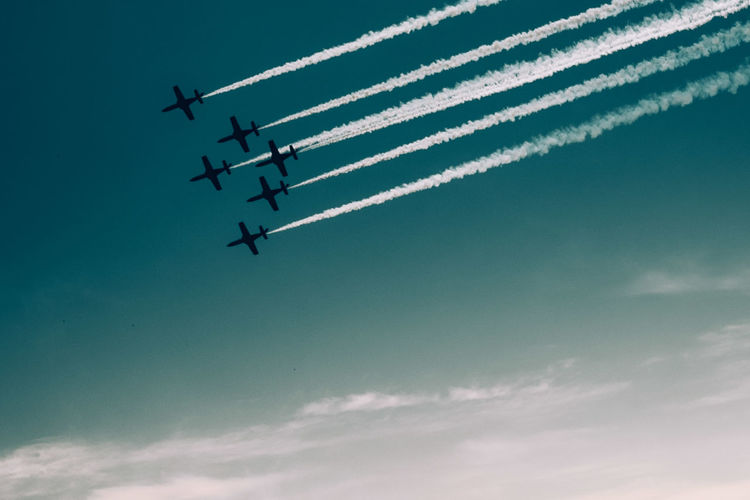 Aerobatics Air Vehicle Airplane Airshow Cloud - Sky Cooperation Fighter Plane Flying Low Angle View Mode Of Transportation Motion Nature No People on the move Outdoors Plane Skill  Sky Smoke - Physical Structure Speed Teamwork Transportation Vapor Trail