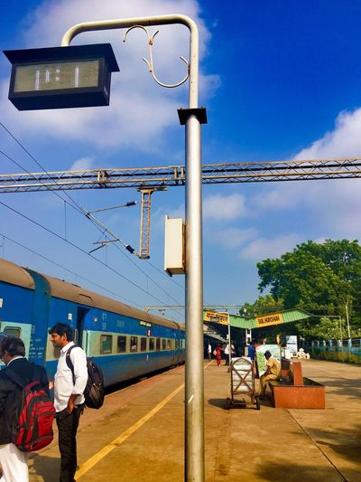 Train Station Train - Vehicle Railway Station Sky Nature Architecture Real People Built Structure Men Building Exterior Transportation Street Light