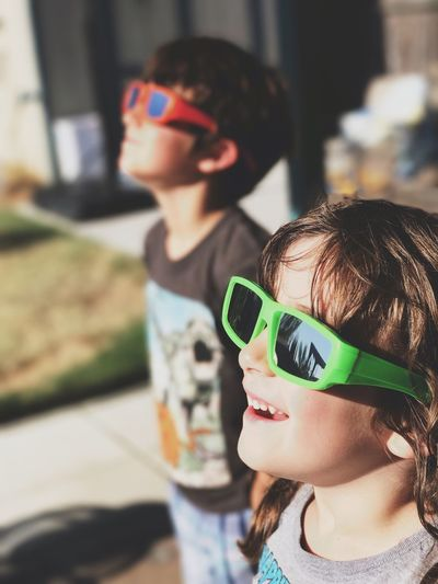Kids wearing solar glasses on sunny day. Sunglasses Childhood Elementary Age Eyeglasses  Focus On Foreground Solar Eclipse Eclipse Eclipse2017 The Week On EyeEm The Week On EyeEm