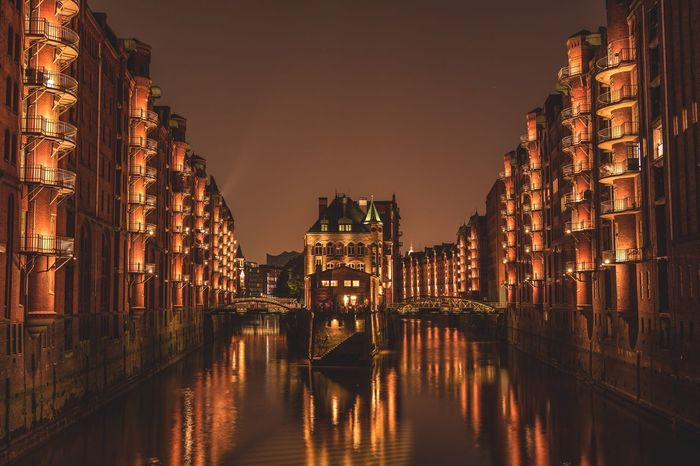 Speicherstadt Architecture Illuminated Building Exterior Built Structure Night Water Reflection Outdoors City Waterfront No People Residential Building Travel Destinations Sky