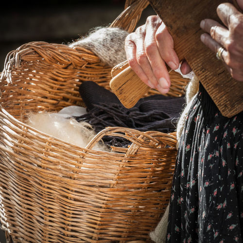 Midsection of woman holding wicker basket