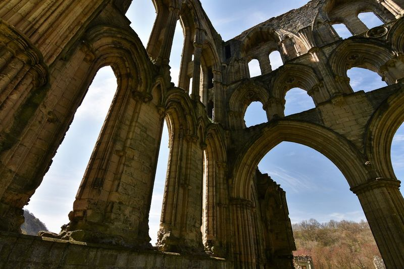 Low angle view of rievaulx abbey against sky