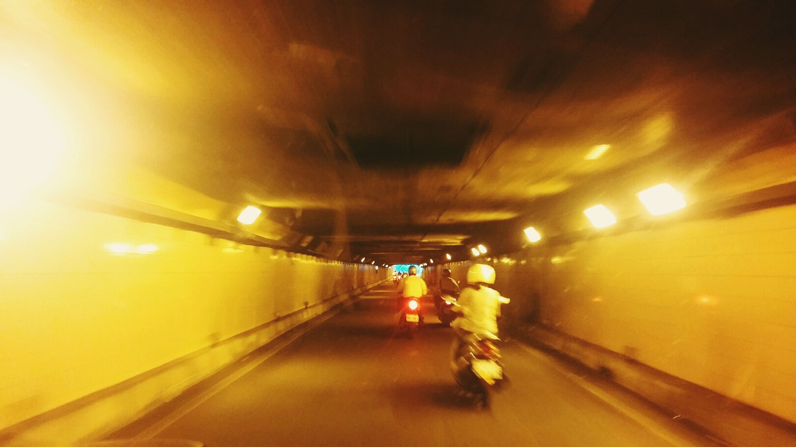 illuminated, indoors, lighting equipment, the way forward, diminishing perspective, transportation, tunnel, ceiling, vanishing point, night, electric light, light - natural phenomenon, arch, built structure, empty, architecture, road, lit, glowing, incidental people