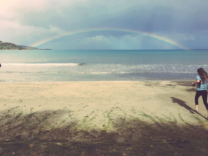 Beach Beauty In Nature Cloud - Sky Day Horizon Over Water Leisure Activity Lifestyles Nature One Person Outdoors People Rainbow Real People Sand Scenics Sea Shore Sky Standing Tranquility Vacations Water Wave The Great Outdoors - 2017 EyeEm Awards