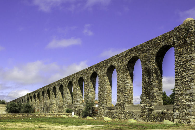 Low angle view of arch bridge against sky