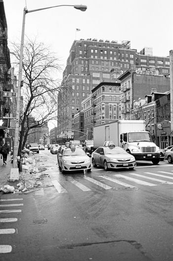 Eight Avenue, Chelsea, January 2016 Contax Contaxt3 Chelsea Manhattan NYC Streetphotography Street Photography Streetphoto_bw Film Photography Neopan Neopan Acros 35mm Film Yellowcab Nyctaxi Snow City Street Slush