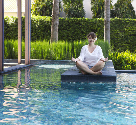 Man sitting in swimming pool