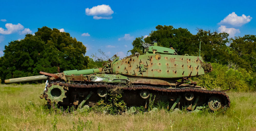Armored Tank On Field Against Sky