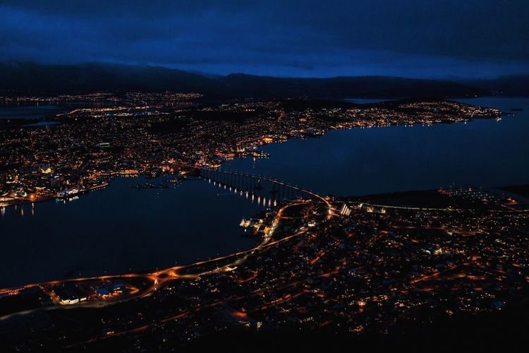 Aerial View Of Tromso Bridge And Illuminated Cityscape At Night