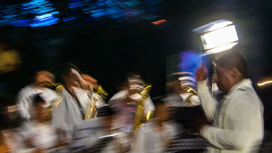 Adult Blurred Motion Crowd Illuminated Large Group Of People Lifestyles Long Exposure Men Motion Musician Night Nightlife Outdoors People Performance Real People Skill  Women