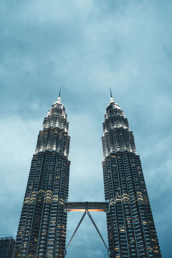The Petronas Twin Towers in Kuala Lumpur surrounded by a beautiful soft twilight blue Kuala Lumpur Kuala Lumpur Malaysia  Architecture Blue Sky Building Exterior Built Structure City Cloud - Sky Day Kl Low Angle View Malaysia Modern Outdoors Petronas Petronas Towers  Petronas Twin Towers Sky Skyscraper Tall Tall - High Tower Travel Travel Destinations Twin Towers The Traveler - 2018 EyeEm Awards