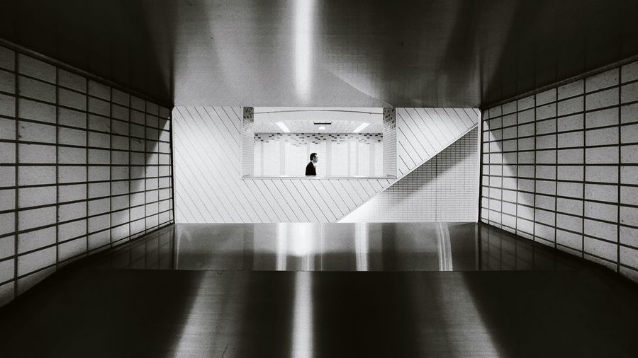 High angle view of woman walking in subway