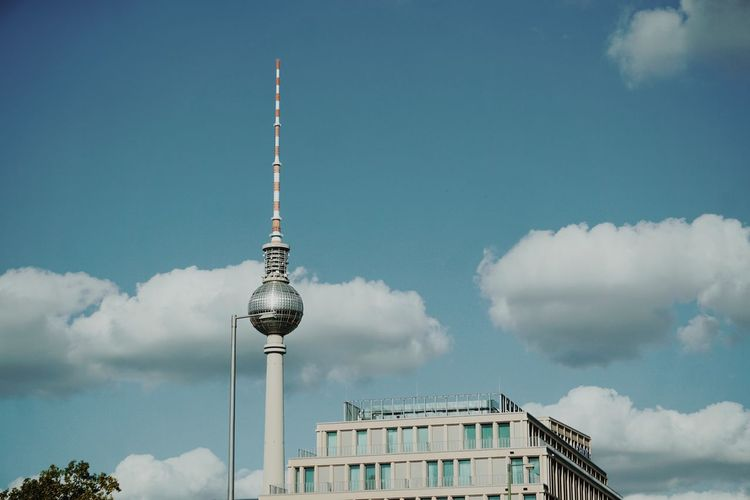 Low angle view of fernsehturm tower against sky