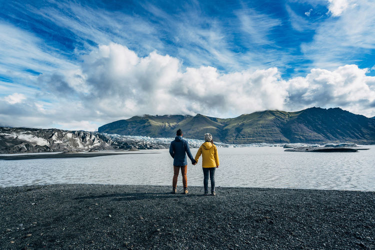 A7RII Adults Only Back Beach Beauty In Nature Blue Cloud - Sky Friendship Full Length Glacier Glaciers Ice Iceland Lake Mountain Mountain Range Outdoors Real People Rear View Scenics Sky Togetherness Travlr Two People Lost In The Landscape