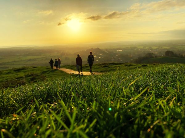 Glastonbury Tor Sunset Grass Nature Sky Landscape Scenics Men Tranquil Scene Field Beauty In Nature Real People Cloud - Sky Tranquility Outdoors Green Color Mountain Growth Togetherness Women Full Length