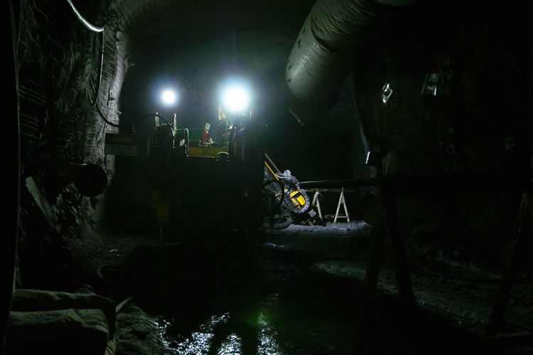 People working in illuminated room at night