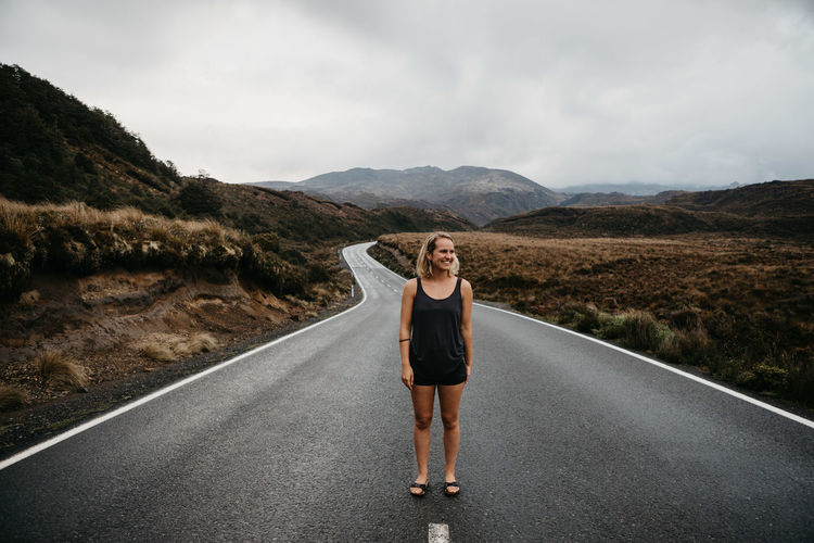 Woman Standing On Road Against Sky