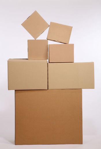 cardboard box on the white background Box Delivery Distribution Moving Stack Transportation Box Box - Container Cardboard Cardboard Box Carton Container Copy Space Fragile Group Of Objects Indoors  No People Object Package Paper Parcel Shipping  Still Life Studio Shot White Background