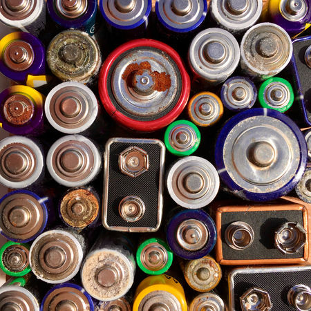 High angle view of old and used batteries for recycling in closeup Alkaline Corroded Corrosion Lithium Aerosol Can Battery Choice Close-up Day Electricity  Electronics  Environment High Angle View Indoors  Ion Large Group Of Objects Lithium Multi Colored No People Old Recharge Recycling Variation Volt Waste