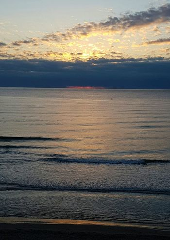 Tranquility Onthebeach Solitude And Silence Relaxed Moments Tranquil Scene Peaceful Beauty In Nature Liguria,Italy Sunriseonthebeach Dramatic Sky Sunlight Horizon Over Water Nature No People Romantic Sky Seaandsky Infinity Beauty In Nature Relaxing View Cloudy Sky Coloredclouds
