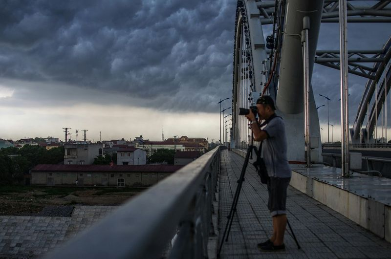 The Moment - 2015 EyeEm Awards My dear older friend, Tran Dai, was hunting thunder on the Dong Tru bridge when a storm came. The wind was too strong and I was shooting by hand, so I just couldn't keep him in focus. Enjoying Life First Eyeem Photo