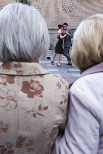 City City Life City Street Couple Dancing Fun Holding Hands Travel Travelling Adult Close Outdoors People Rear View Senior Adult Senior Women Street Street Performers Tango Tango Dancers Travel Destinations Two People Women