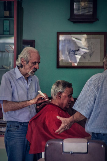 Hairstyles Adult Adults Only Casual Clothing Community Outreach Day Gray Hair Hairdresser Hairdressing Home Caregiver Home Interior Human Hand Indoors  Men Patient People Real People Retirement Senior Adult Senior Men Sitting Standing Togetherness Two People Women