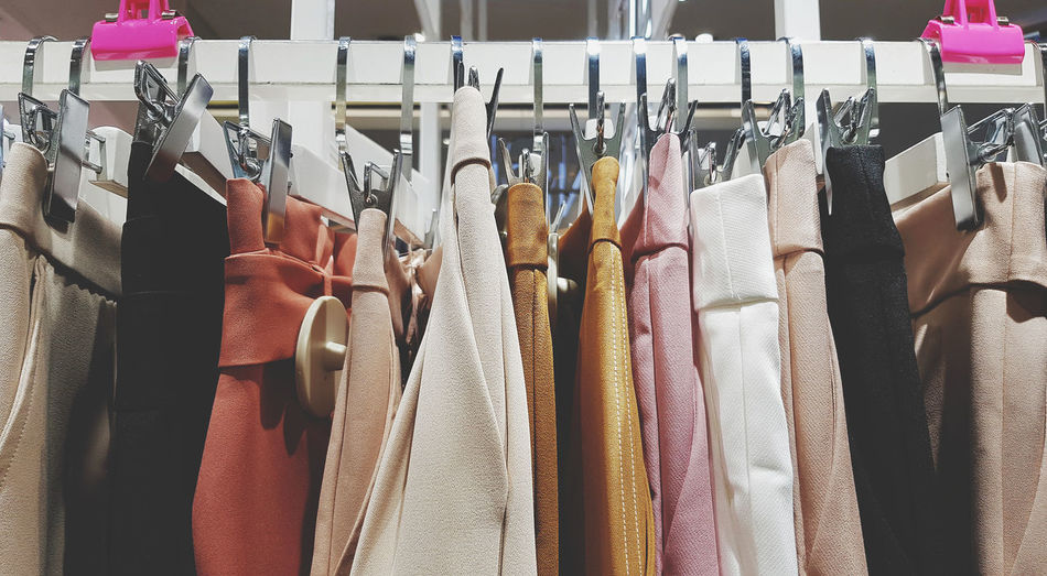 Row of clothes hanging in rack