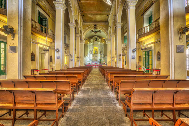 Macau, China - December 8, 2016: interior of Saint Dominics Church, baroque style cathedral at Senado Square in Historic Centre of Macau, Unesco Heritage Site, one of major tourist attractions. Macao  Hotel Skyline Galaxy Saint Dominic's Church Saint Dominic's Church Interior Religion Mass Architecture Chinese China Built Structure Building The Way Forward Direction Place Of Worship Building Exterior Spirituality Arch Belief Pew Day Diminishing Perspective No People In A Row Architectural Column Aisle