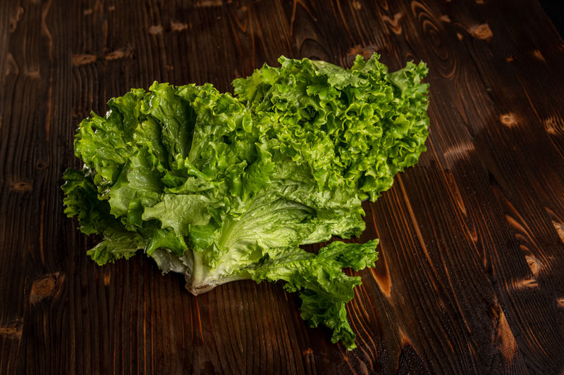 High angle view of chopped leaf on cutting board