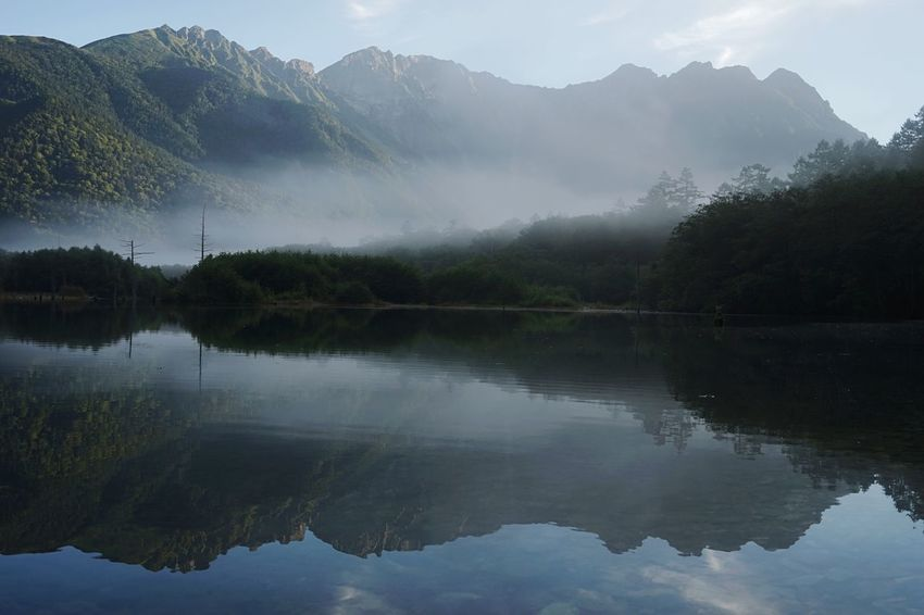 Reflection Mountain Water Scenics Tranquil Scene Tranquility Lake Beauty In Nature Majestic Mountain Range Forest Waterfront Fog Standing Water Calm Idyllic Symmetry Nature Non-urban Scene Growth Taishoike Lakeside Foggy Kamikochi in Toyoshina Nagano Japan Finding New Frontiers