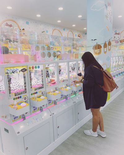 Kid at heart Kid At Heart  Female People Toycranes Toys Moments Capturedmoments Taiwan Travel Vacation Play Toys Ximending Full Length Women Multi Colored Business Finance And Industry Mid Adult Standing Retail  Choice Modern