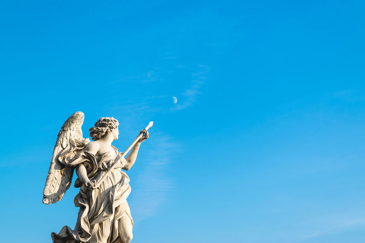 Moon Angel Statue Sculpture Rome Italy Art History Arrow Blue Deep Blue Copy Space Low Angle View Standing Day Outdoors Sky Clear Sky A New Perspective On Life
