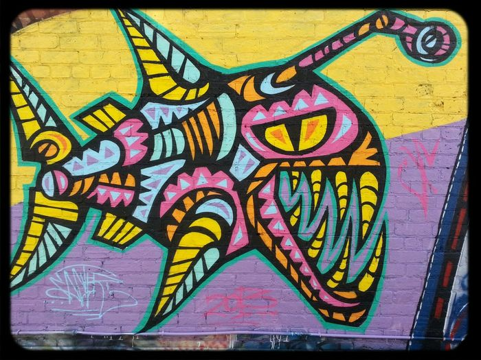Streetart by Facter of a mutant robot deepsea Fish in Technicolor