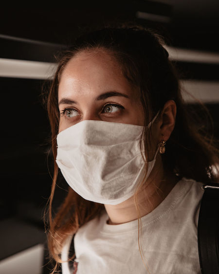 Portrait of a beautiful young woman wearing a face mask
