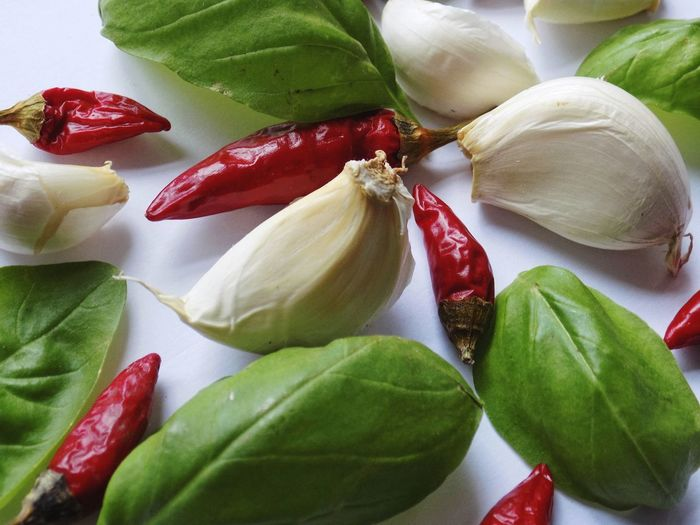 Chili Pepper Chili  Seasoning Seasonings EyeEm Best Shots Taking Photos Taking Pictures Leaf Red Close-up Food And Drink Green Color Garlic Bulb Basil Leaf Vegetable Garlic Clove Ingredient Italian Food Garlic