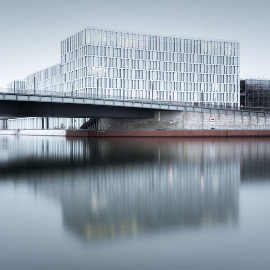 Modern Offices along the Spree river in Berlin Architecture Berlin Berlin-Mitte Bridge - Man Made Structure Business Finance And Industry City City Cityscape Day Fineart Germany Longexposure Modern Architecture Modern Office Nature No People Outdoors Philipp Dase Reflection Reflections In The Water Sky Spree River Berlin Water Waterfront Berlin Discover Berlin