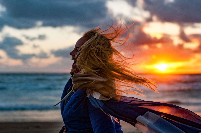 enjoy Beauty In Nature Day Horizon Over Water Leisure Activity Lifestyles Long Hair Motion Nature One Person Outdoors People Real People Scenics Sea Sky Sunset Water Press For Progress