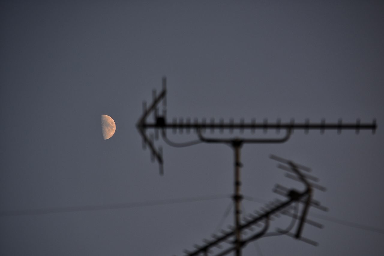 sky, moon, nature, low angle view, antenna - aerial, technology, space, dusk, planetary moon, connection, astronomy, no people, outdoors, full moon, communication, silhouette, night, sunset, clear sky, television aerial, moonlight