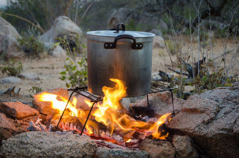 Close-Up Of Saucepan On Bonfire In African Bush