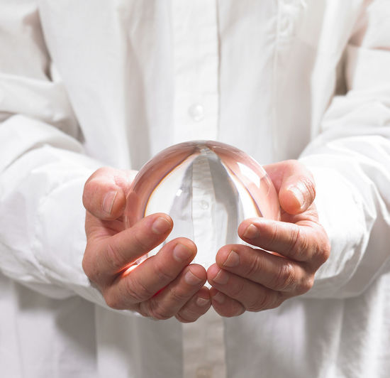 Crystal ball Adult Close-up Contemplation Crystal Ball Focus On Foreground Forecasting Front View Glass - Material Hand Hands Cupped Holding Human Body Part Human Hand Indoors  Lab Coat Men Midsection Occupation One Person Sphere Transparent White Color