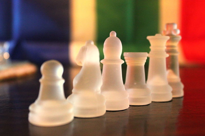Challenge Checked Pattern Chess Chess Board Chess Piece Close-up Competition Day Focus On Foreground Frosted Glass Indoors  Intelligence King - Chess Piece Knight - Chess Piece Leisure Games No People Pawn - Chess Piece Queen - Chess Piece Skill  Still Life Strategy White Color
