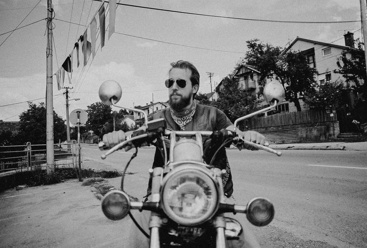 Analogue Photography Architecture Biker Building Exterior Built Structure City Day Film Photography Front View Lifestyles Looking At Camera Mode Of Transportation Motorcycle Nature One Person Outdoors Portrait Real People Road Sky Street Superia100 Transportation